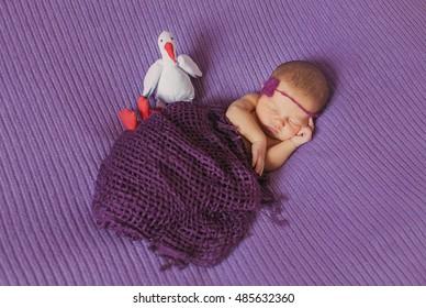 little  newborn girl  sleeping in  the bed