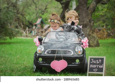 little newlyweds in a small toy car
