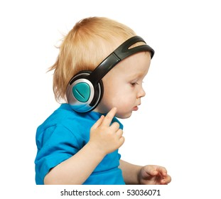 Little nice boy listening to music, isolated on white