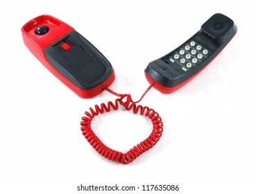Little and old red and black phone with heart shaped cable