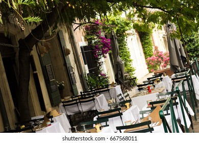 Little old rustic restaurant in France - tables outside under the tree