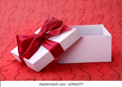 Little open red gift  on red background