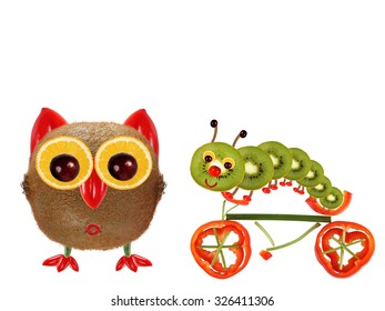 The little owl and a caterpillar on a bicycle made from vegetables and fruits