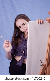 Little painter lloking behid easel