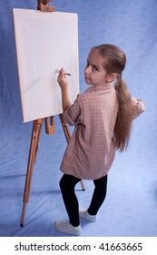 Little painter stay near easel