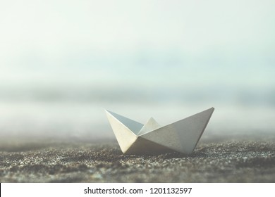 little paper boat on the sand