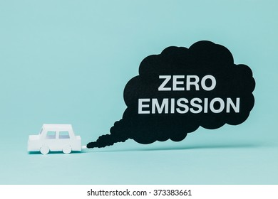 Little paper car crating a zero emission smoke cloud while running.