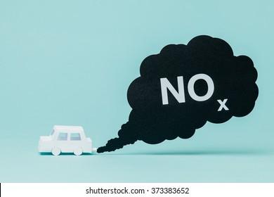 Little paper car creating nitrogen oxide emissions while running.