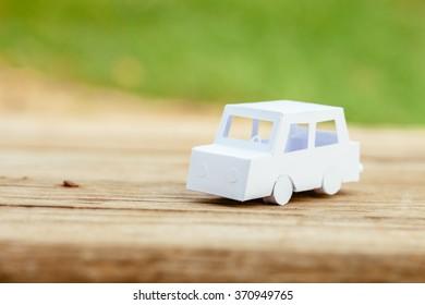 Little paper car outdoors.