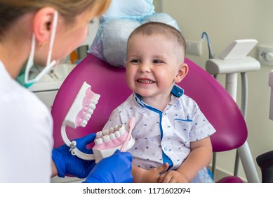 Little patient looking how to clean teeth right