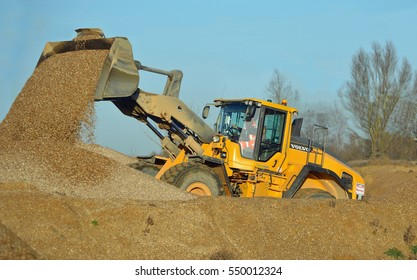 LITTLE PAXTON, CAMBRIDGESHIRE, ENGLAND -  JANUARY 05, 2017: JCB working in gravel yard.