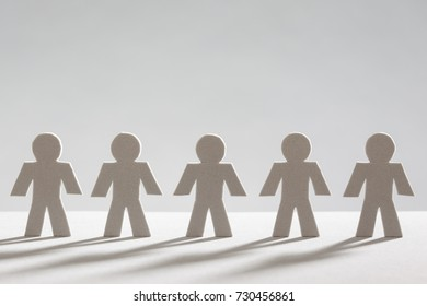 Little People, Simple Team, Grey people in a row on Grey Background