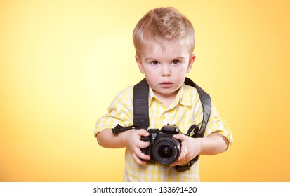 little  photographer with professional photo camera