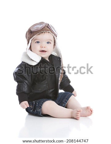Little pilot. Adorable baby boy dressed in a pilot hat with goggles and  wearing a leather bomber jacket. Isolated on white with room for your text.  - Image 3c86ca85f88