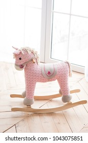 Little pink pony rocker swing doll on a wooden floor