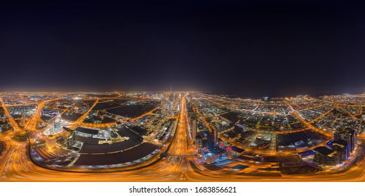 Little planet 360 degree sphere. Panorama of aerial view of Dubai Downtown skyline and highway, United Arab Emirates or UAE. Financial district in urban city. Skyscraper buildings at night.