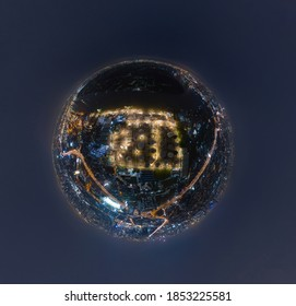 Little planet 360 degree sphere. Panorama of aerial view of petrochemical oil refinery and sea in industrial engineering concept in Bangna district at night, Bangkok City, Thailand. Oil and gas tanks