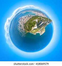 Little planet composition of an aerial view of the top of Gibraltar Rock, located in the Upper Rock Natural Reserve. United Kingdom, South West Europe. Globe concept, ecosystem, earth.