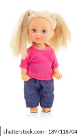 little plastic doll, baby girl. Little blonde doll with blue eyes on white bg. Isolated on white background with shadow reflection. With red shirt and checkered pants.