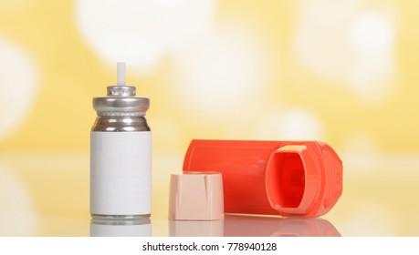 Little pocket inhaler, bottle with dispenser for inhalation, on light yellow background