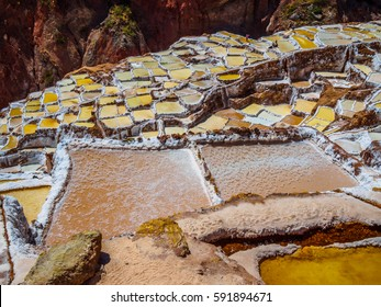 The little pools of Maras Salina, in the Sacred Valley of Peru, high angle