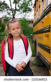 Little Preteen Schoolgirl Waiting for Schoolbus to open a Door