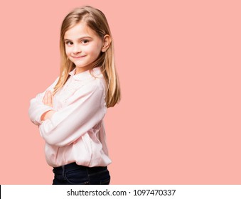 little pretty girl with crossed arms. happy and satisfied expression