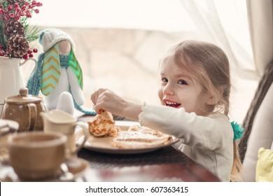 Little pretty girl eating breakfast, indoor
