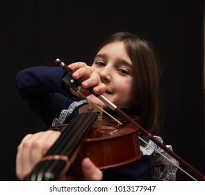 Little pretty girl playing violin