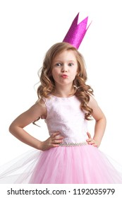 Little princess girl in pink dress and crown giving a kiss , studio isolated on white background