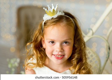 little princess sitting near the table in classic dress and vintage atmosphere of the room