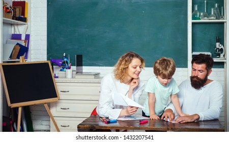 Little ready to study. Pupil of primary school study indoors. Supporting pupils at school. Cute pupil and his father and mother making schooling work. Education