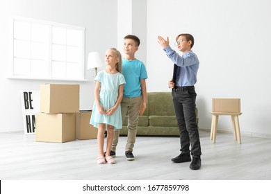 Little real estate agent showing clients a new house