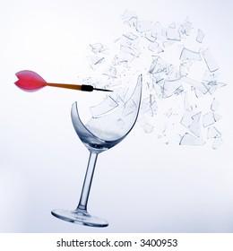 little red  arrow breaking a wine glass