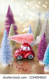 Little red car with christmas tree , transporting christmas tree