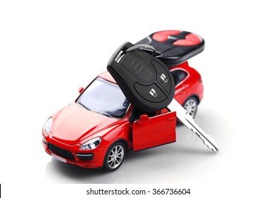 Little red car with key isolated on white background