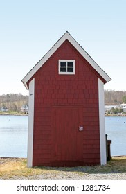 Little red fishing shed along the bay