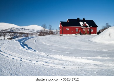 little red house in sweden in the winter
