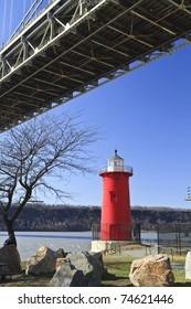 The 'Little Red Lighthouse' underneath the George Washington Bridge on the Hudson River in upper Manhattan in New York, NY