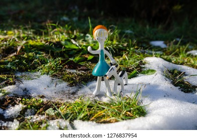 Little red riding hood and the wolf - porcelain figurine in the winter forest