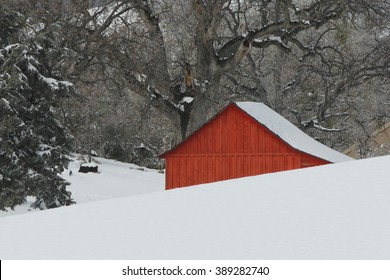 The little red schoolhouse in the snow.