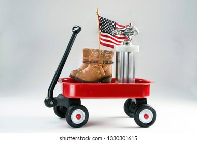 Little red wagon with auto trophy and boots.