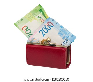 Little red womens wallet with modern Russian money on a white background