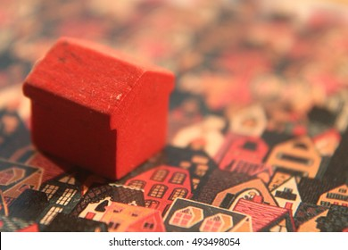 Little red wooden house among other ones. Nice image for using.