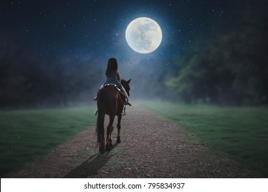 The little rider strolls along the way on a full moon day.