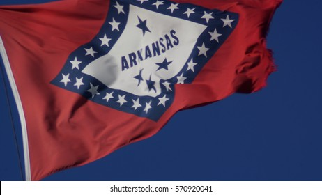 Little Rock Arkansas Jan 29, 2017: The Arkansas state flag waves in the wind on the State Capitol grounds in Little Rock, Arkansas