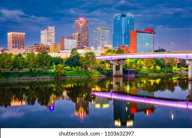 Little Rock, Arkansas, USA skyline on the river at twilight.