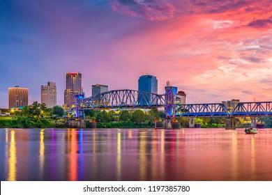 Little Rock, Arkansas, USA skyline on the Arkansas River at dusk.