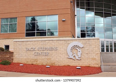Little Rock, AR/USA: March 29, 2018 – Sign for Jack Stephens Center at University of Arkansas at Little Rock welcomes visitors to campus. Trojans Logo also shown.
