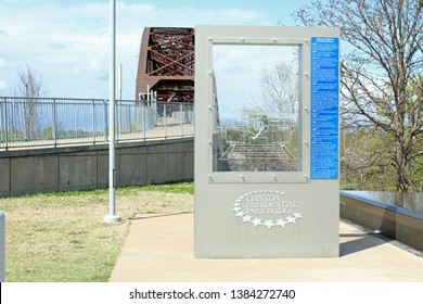 Little Rock, AR/USA: March 29, 2018 – Sign at Clinton Presidential Park Bridge for pedestrian pathway renovated from old railroad bridge. It is part of 88 mile loop of Arkansas River Trail.